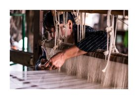 woman with a weaving machine by lightdrafter