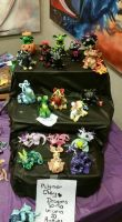 polymer clay dragons and beasties at craft fair  by ingaca03