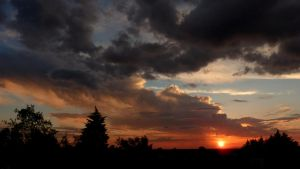 Storm at sunset II by cacador