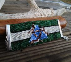 One In Three and Three In One - Three Hares Cuff by TarpanBeadworks