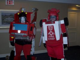 Inferno and Red Alert costumes by evilkillerpoptarts
