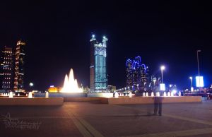 night walker in Abu Dhabi Corniche by amirajuli