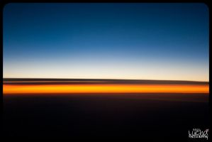 Sunrise from a plane by misslucha