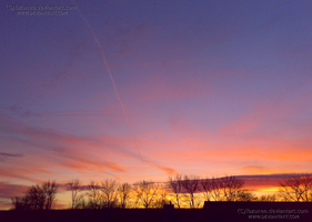 From my window - sunset as gold and fire by Tazunee