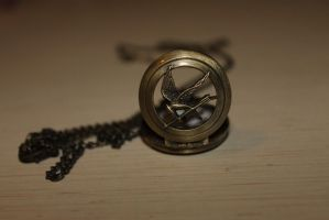 Hunger Games Clock-Necklace by Koe99