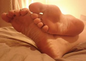 Relaxed Soles On Bed by Whor4cle