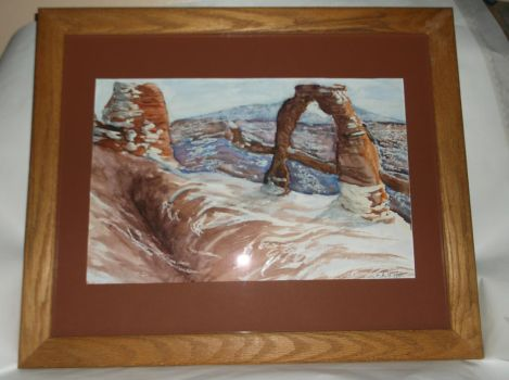 Delicate Arch in Snow by bronzesketch