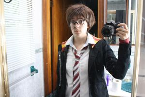 Harry Potter is disheveled... by HarajukuShoujo