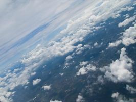 Clouds from Airplane Window 2 by Scorpini-Stock