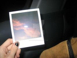 Polaroid of the sky. by alonebutloved