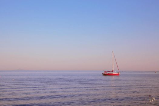 lonely red yacht by iliannaphotography