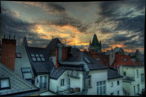 Sunset above Prague roofs. by knz