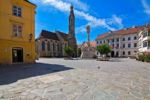 Square in old city center by olgaFI