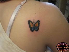 small butterfly tattoo by theothertattooguy