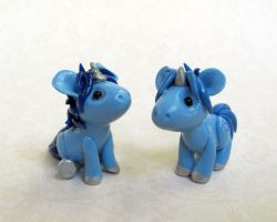 Blue Baby Unicorns by DragonsAndBeasties