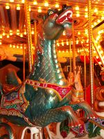 CHILD EATING DRAGON GO ROUND by CorazondeDios