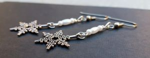 Pearly white beads with snow flake charm earrings by TEDSbyBri