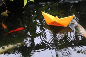 Origami boat on the water by woutiou