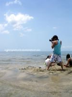 photographer in action by reginepetrola