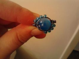 Blue ring by KnittedWonders