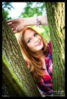 A girl and the tree ID by Lumis-Mirage