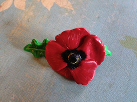 Poppy hair clip by Firestorm-the-Poet