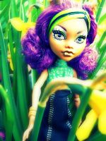 Clawdeen and the daffodils by RedHotHawk
