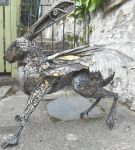 GOLDEN STEAMPUNK FLYING HARE SCULPTURE OUTSIDE by Daicelf