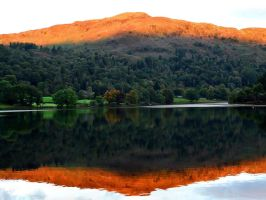 Autumn sun lights the peaks in the Lake District by Lord-Storm