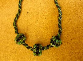 Beaded bead spiral necklace by slinkyskinked