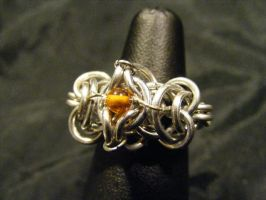 amber chainmail ring by BacktoEarthCreations