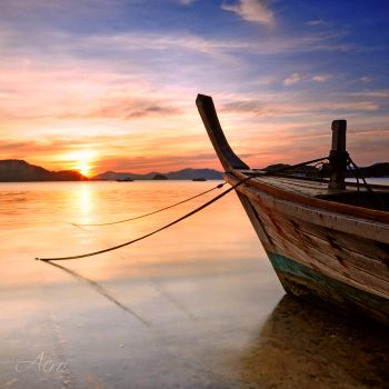 Long-tail boat and sunset by acro-phuket