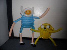 Finn the human with jaundice and Jake the dog by TwistyMcJones