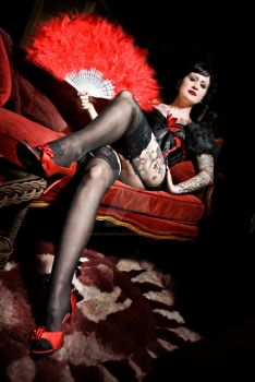 Red heels and feather fans by redbootsphotography