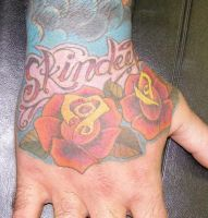Skin deep Rose hand tattoo by Inkcastle