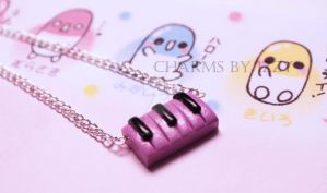 Cute pink piano keyboard necklace polymer clay by CharmsByIzzy