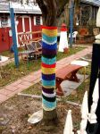 yarn bomb tree by knittleson