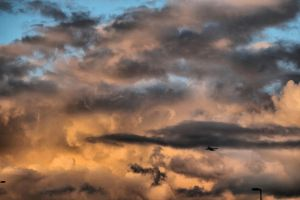 plane in takeoff with clouds by Yoquini