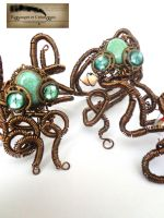 Couple of mecanical steampunk octopus bracelet by Rouages-et-Creations