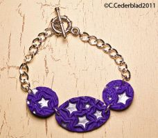 Purple polymer clay bracelet by skuggsida