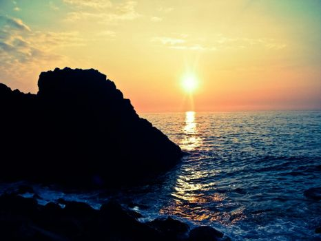 Sunset Behind Rocks by lilfes