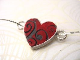 Red black heart necklace by TopazTurtle