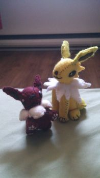 Eevee and Jolteon plushies by NerdLass