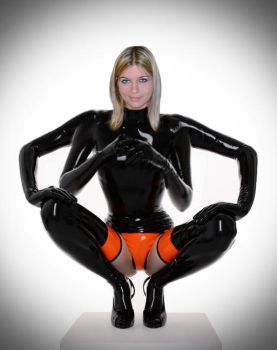 Four armed blonde girl in a latex catsuit by jenny0046