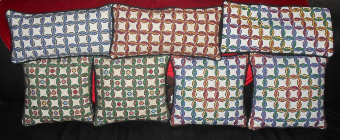 Interlocking Rings Cross-stitched Pillows by EmpyP