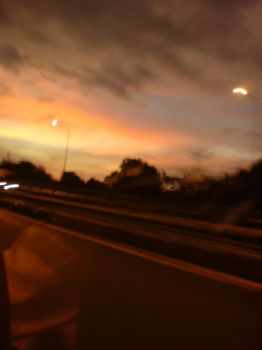 sunset from the highway by kryztaleo