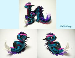 Turquoise Dragon with Baby by SweetMayDreams